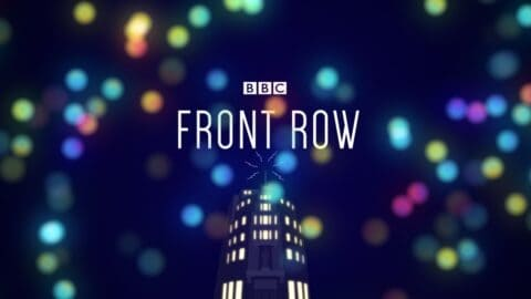 """BBC Front Row logo, a dark rectangle with coloured spots, a tall building and the words """"Front Row"""""""